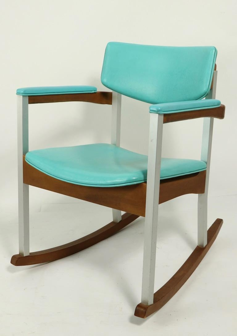 Unusual and rare model Thonet wood, aluminum and vinyl rocking chairs, total of four available, three in green vinyl, one in turquoise vinyl upholstery. Build to commercial standards, solid and sturdy, clean and ready to use condition. Offered and