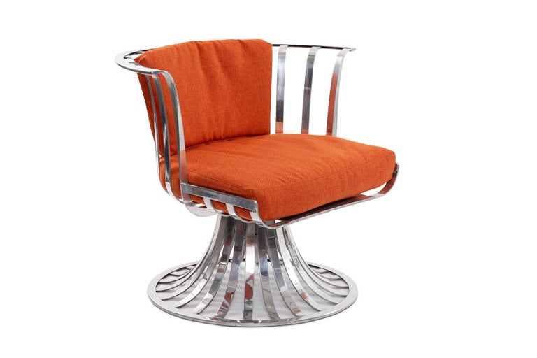 4 slatted aluminum swivel lounge chairs designed by Russell Woodard, circa early 1960s. These examples can be used indoors or out. These have been newly reupholstered in bright orange fabric. Price listed is per chair.