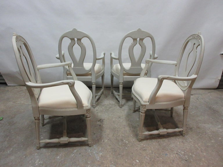 This is a set of 4 Swedish Gustavian armchairs. They have been restored and repainted with milk paints