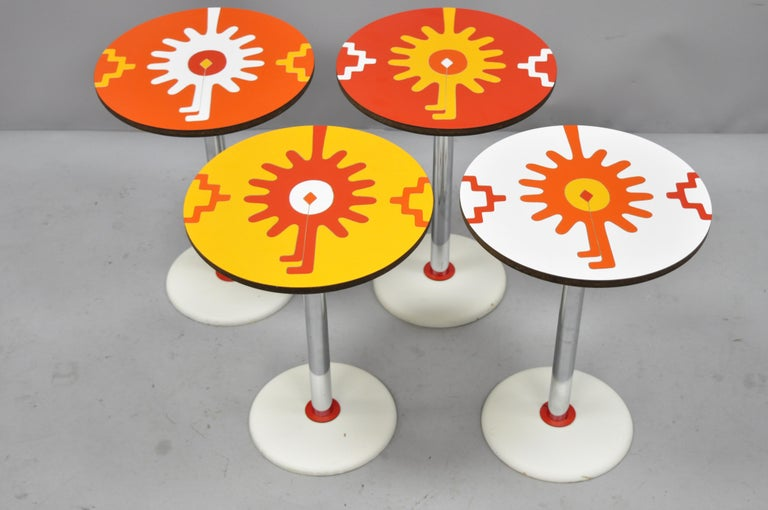Set of 4 vintage orange yellow white geometric pattern round side tables by R. Johnson. Listing features (4) tables, colorful laminated tops, chrome column, wooden base, signed