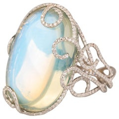 40 Carat Blue Sheen Moonstone Ring with 1.92 Carat of Diamonds