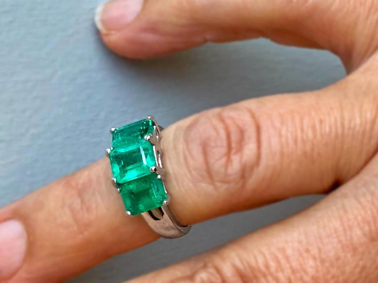 This is a beautiful and classic design Emerald Platinum Three Stone Engagement Ring Feature three genuine and natural COLOMBIAN emeralds, emerald cut weighing approx. 4.0 Carat. The emerald are prong set shimmering medium green, clarity VS. The ring