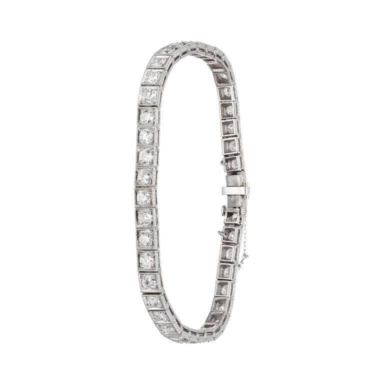 Vintage diamond and platinum tennis bracelet old European cut diamonds set in a square link with mil-grain edges around each square. Closed with a box style lock with safety underneath and additional safety chain.   42 old European cut diamonds H-I