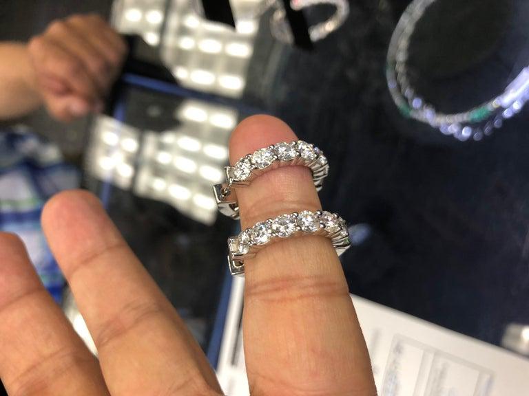 One 18K Yellow Gold diamond Hoop earrings features: - 4.10 Carats of Round cut Diamonds.  - 20 Round Cut Diamonds - Each stone 0.20 Carats - Oval Shaped - 1