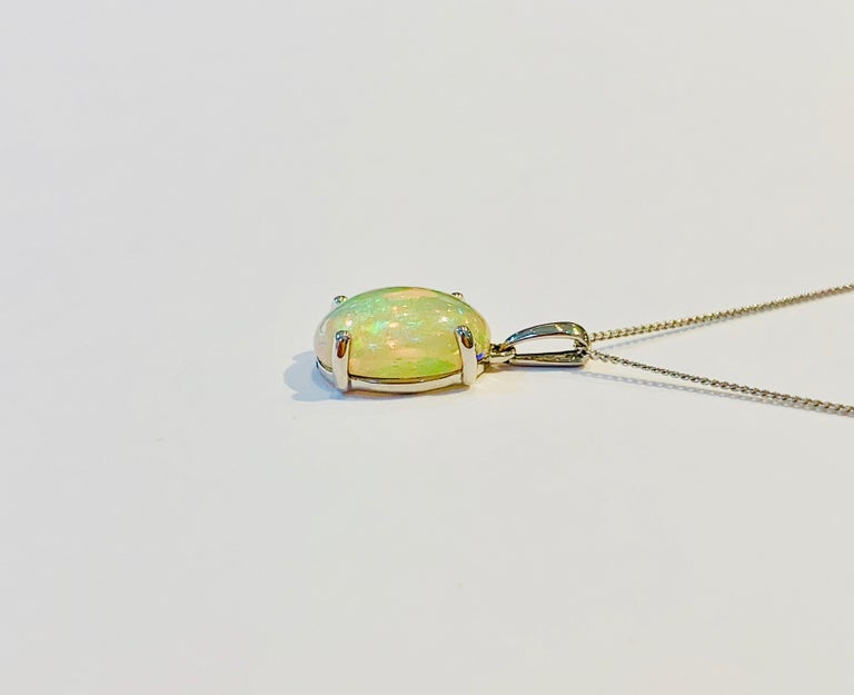 Modern 4.00 Carat AAAA Oval Welo Opal Pendant in Platinum with Platinum Chain For Sale