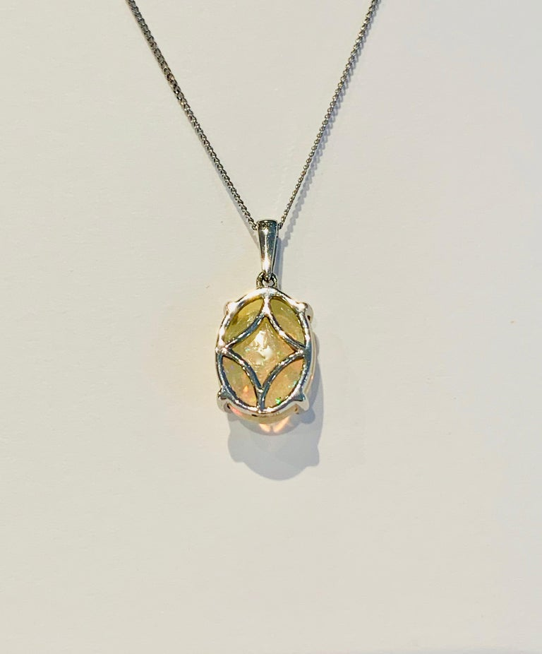 Oval Cut 4.00 Carat AAAA Oval Welo Opal Pendant in Platinum with Platinum Chain For Sale