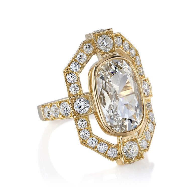 4.02ctw M/VS1 GIA certified Cushion cut diamond with 1.79ctw old European cut accent diamonds set in a handcrafted 18K yellow gold mounting.  Ring is a size 6 and can be sized to fit.