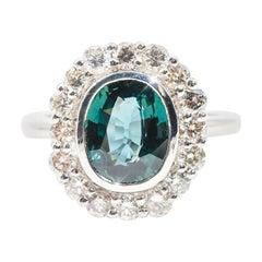 4.02 Carat Oval Unheated Colour Shift Sapphire and 1.18 Carat Diamond Halo Ring