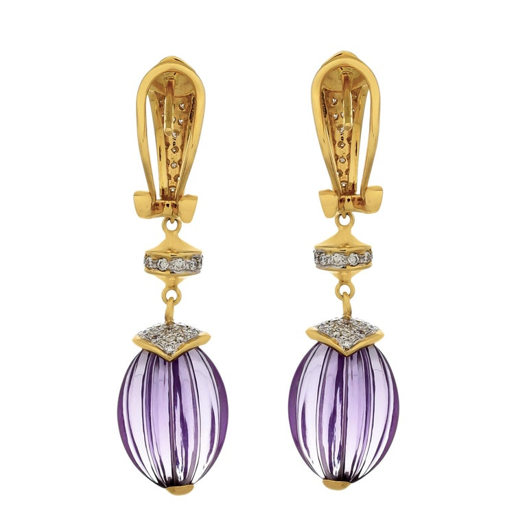 Fine luxury gets an avant garde lift through these stunning drop earrings crafted with pastel hues of hand carved amethyst melons weighing approximately 40.28 carats and gleaming glow of diamonds with a total diamond weight of 1.65 carats. These are