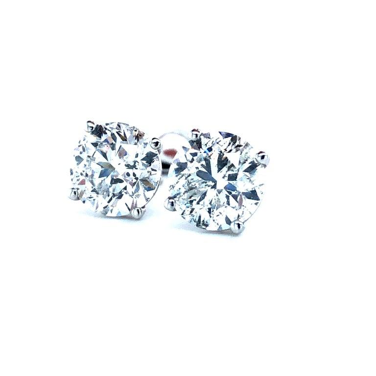 Brilliant Cut 4.03 Carat Diamond Stud Earrings For Sale