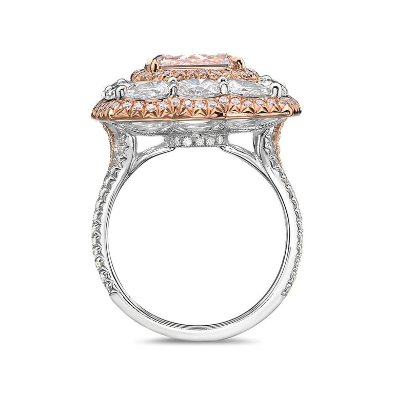 This 4.04 carat VS1 square radiant cut fancy brown pink diamond engagement ring features 0.37 carats of round diamonds and 1.97 carats of pear and marquise shape diamonds set in 18K white and rose gold. Total weight 9 grams. Size 6.  Can be resized