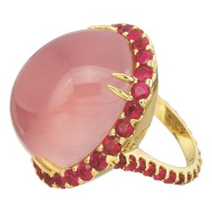 40.43 Carat Rose Quartz Oval Cabochon and Ruby Cocktail Ring