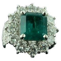 4.06 Carat Emerald Ring with 2.22 Carat of Diamond