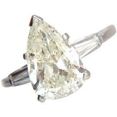 4.06 Carat Natural Pear Shape Diamond Platinum Ring Baguette Classic