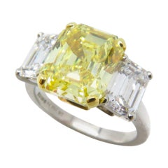 4.07 Carat Fancy Vivid Emerald Cut Yellow Diamond Three Stone Engagement Ring