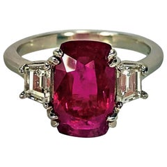 4.07 Carat Mozambique Ruby and Diamond Three-Stone Ring Set in Platinum