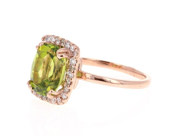 Modern 4.07 Carat Peridot Diamond 14 Karat Rose Gold Ring For Sale