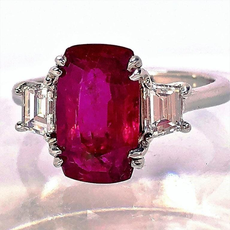 Cushion Cut 4.07 Carat Mozambique Ruby and Diamond Three-Stone Ring Set in Platinum For Sale