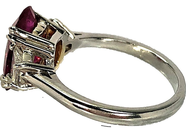 4.07 Carat Mozambique Ruby and Diamond Three-Stone Ring Set in Platinum For Sale 1