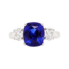 4.09 Carat Cushion Sapphire and Diamond Three-Stone Platinum Engagement Ring