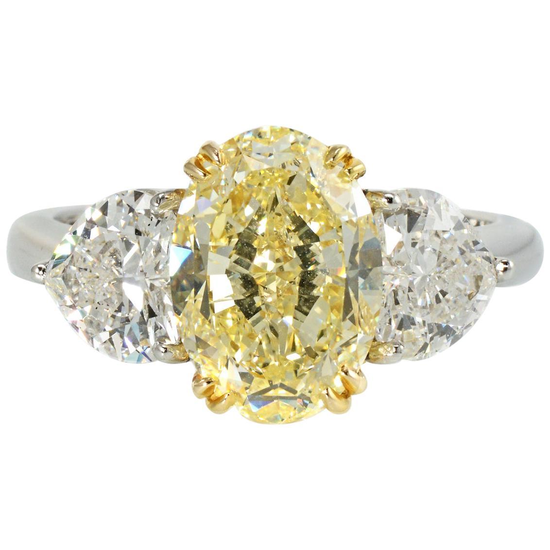 4.09 Carat Oval Cut Fancy Yellow Three-Stone Diamond Engagement Ring