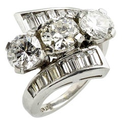 4.10 Carat Diamond Crossover Platinum Ring, circa 1940