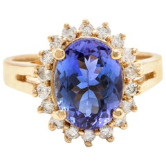 4.10 Carat Natural Tanzanite and Diamond 14 Karat Solid Yellow Gold Ring