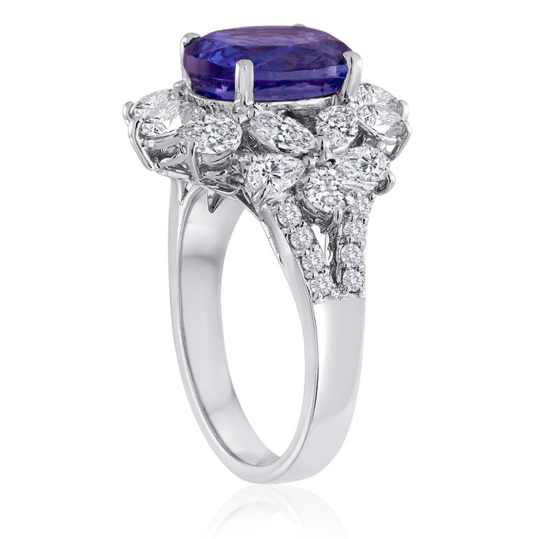 Classic Cocktail Ring The ring is 18K White Gold There are 2.25 Carats in Diamonds F/G VS/SI The Center Stone is 4.10 Carats Tanzanite The ring is a size 6.5, sizable The ring weighs 7.9 grams