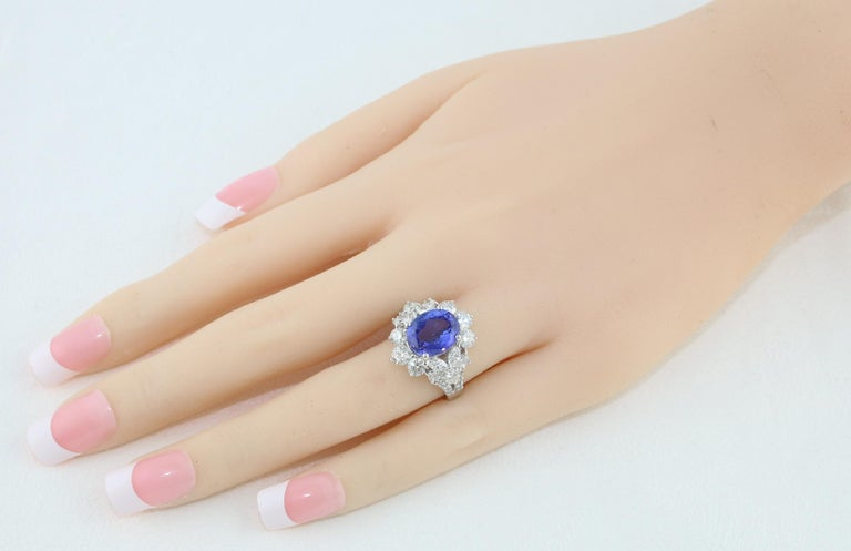 Contemporary 4.10 Carat Oval Tanzanite Diamond Gold Ring For Sale