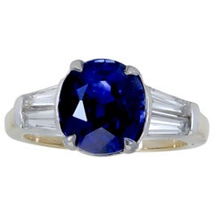 4.11 Carat Blue Sapphire and Diamond Three-Stone Engagement Ring