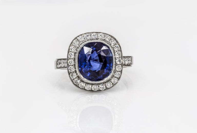 Contemporary Roman Malakov Cushion Cut Royal Blue Sapphire and Diamond Halo Engagement Ring For Sale