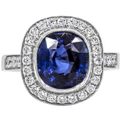 4.12 Carat Cushion Cut Royal Blue Sapphire and Diamond Halo Engagement Ring