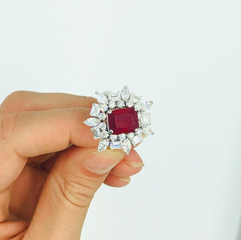 Emerald-Cut Ruby = 4.12 Carat ( Natural Ruby, Color Enhanced ) Diamonds = 3.44 Carats ( Color: F; Clarity: VS ) 18K White Gold