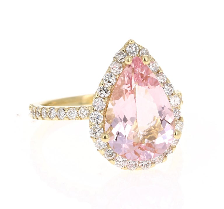 A lovely Engagement Ring Option or as an alternate to a Pink Diamond Ring!   This gorgeous and classy Morganite Diamond Ring has a 3.25 Carat Pear Cut Pink Morganite and has a Halo of 45 Round Cut Diamonds that weigh 0.87 carats (Clarity: VS2,