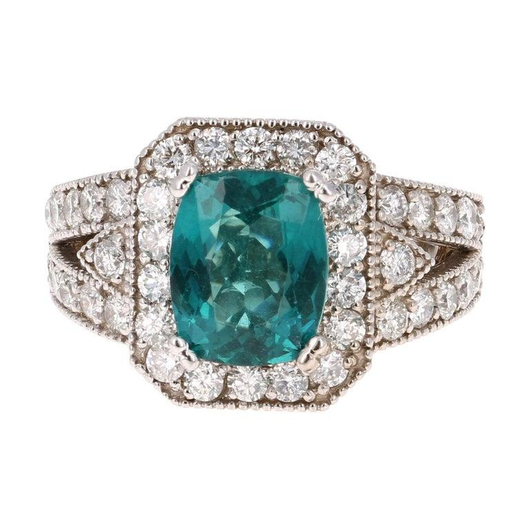 An Apatite Ring set beautifully in White Gold - such a beautiful and unique combination!!  This stunning Apatite and Diamond Ring can easily transform into a unique and classy engagement ring for your special someone! The ring has a 2.75 Carat