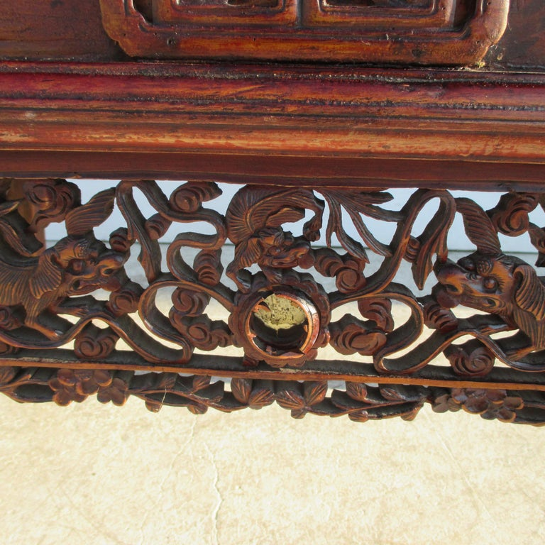 19th century Chinese alter console  Qing period piece featuring two drawers with brass pulls. Carved apron and sides.  Measures: 41.5