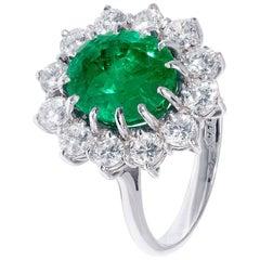 4.15 Carat Emerald Ring with White Diamond Halo