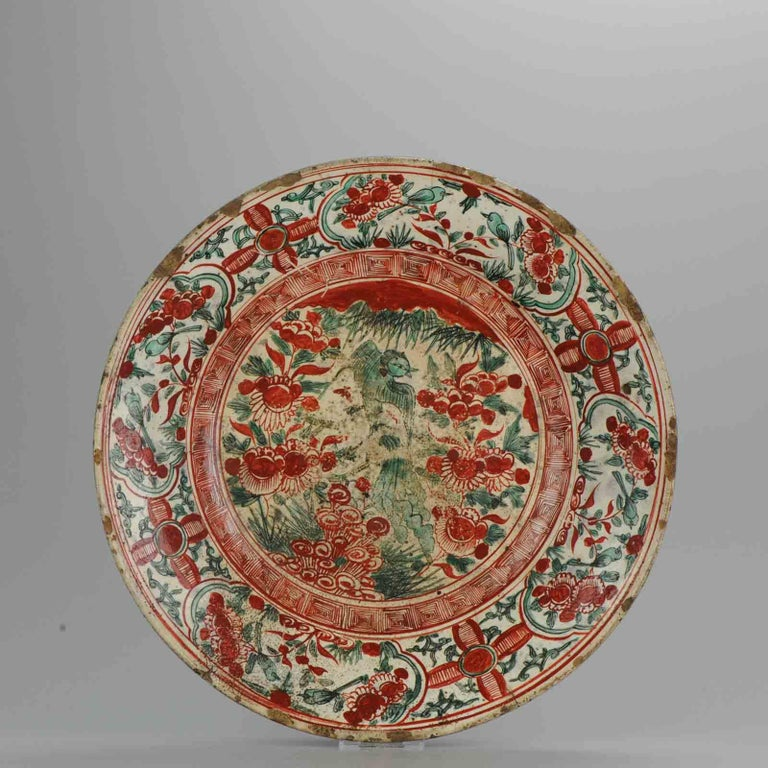 Great Ming plate. Most likely 16th-17th century. Southern China, Swatow, Zhangzou. Decoration of birds. Condition: Overall condition, hairlines, large chips, firing flaws. Partly recolored red. Size: 415 mm x 64 mm Period: 16th century 17th
