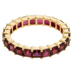 4.16 Carat Square Cut Ruby Eternity Band in 18 Karat Yellow Gold