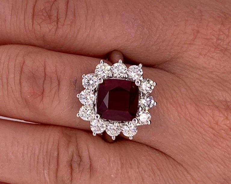 4.2 Carat Cushion Ruby and Round Diamond Halo Engagement Ring 18K White Gold In New Condition For Sale In GREAT NECK, NY