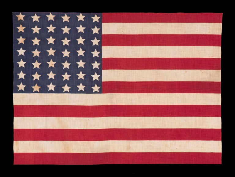 42 stars in a Wave configuration of lineal columns, never an official star count, 1889-1890, Washington Statehood: