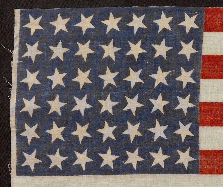 This is an uncommon 42-star flag, commemorating the addition of the state of Washington to the Union. The flag dates to 1889-1890, and is printed on cotton. The canton consists of six rows of seven dancing stars, which is an unusual star pattern.