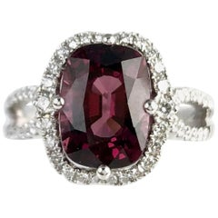4.20 Carat Cushion Cut Garnet Ring with White Diamond Halo in 18 Karat Gold