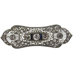 4.20 Carat White Diamond 0.20 Carat Blue Sapphire White Gold Brooch