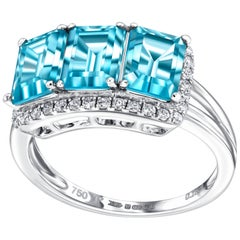 4.20ct Emerald Cut Blue Topaz 0.25ct Diamond Halo 18 Karat White Gold Ring