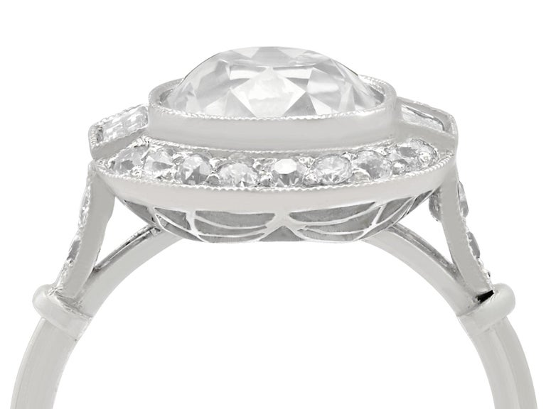A stunning antique and contemporary 4.23 carat diamond and platinum halo style dress ring; part of our diverse diamond and estate jewelry collections.  This stunning, fine and impressive diamond engagement ring has been crafted in platinum.  The