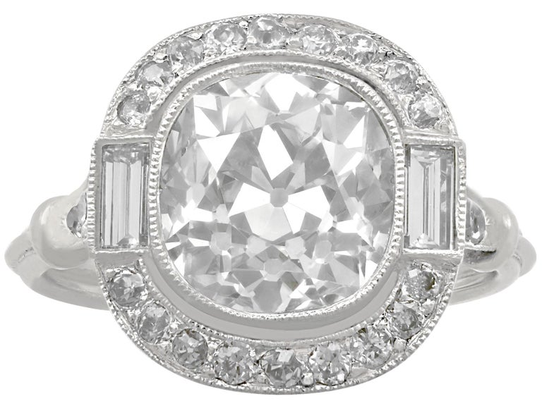 Round Cut 4.23 Carat Diamond and Platinum Halo Engagement Ring For Sale