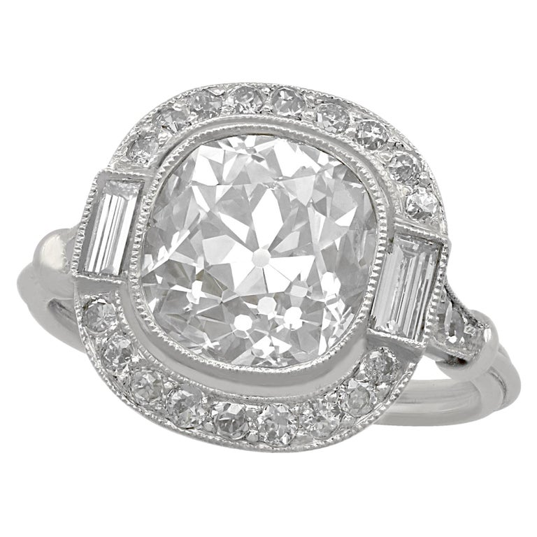 4.23 Carat Diamond and Platinum Halo Engagement Ring For Sale