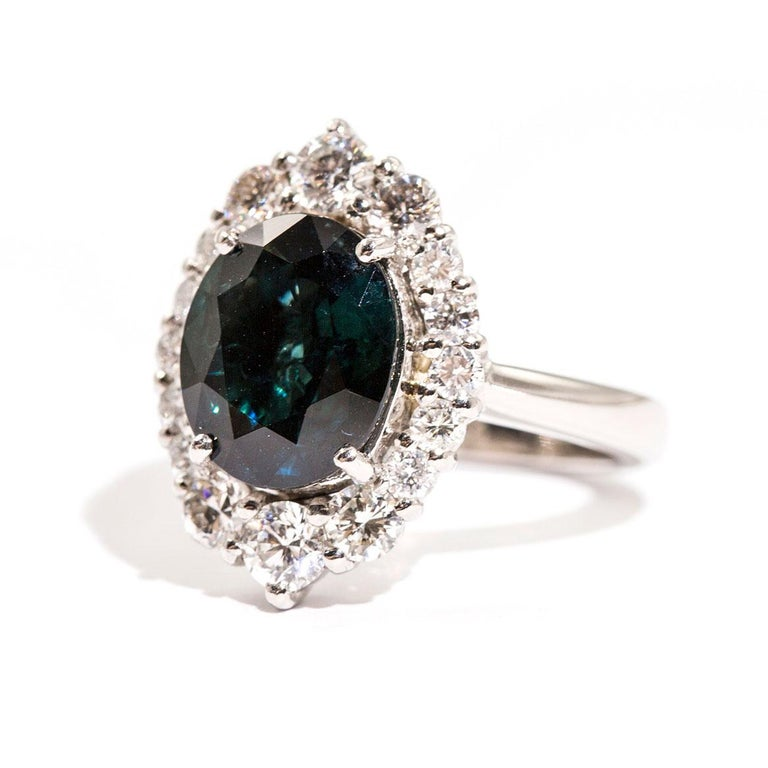 Women's 4.25 Carat Oval Teal Colour Sapphire and 1.16 Carat Diamond Halo Platinum Ring For Sale