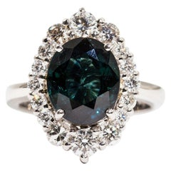 4.25 Carat Oval Teal Colour Sapphire and 1.16 Carat Diamond Halo Platinum Ring